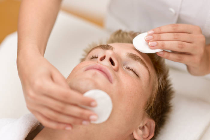 Male cosmetics - cleaning face treatment at luxury spa
